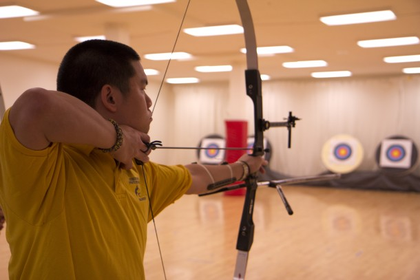 Student playing with bow and arrow i