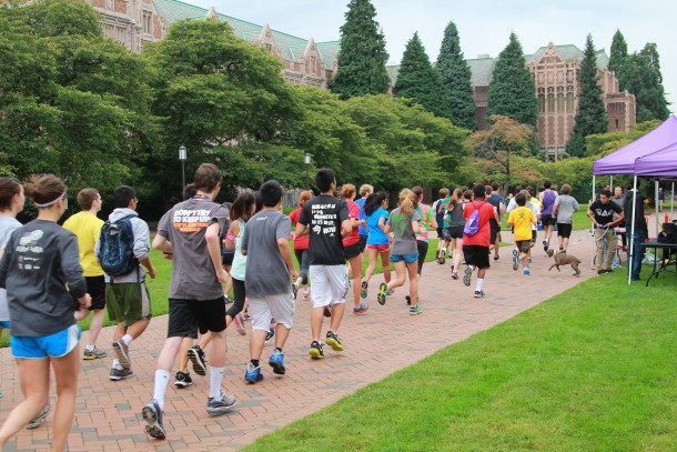 Students running on the quad