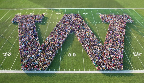 "Students forming a large ""w"""