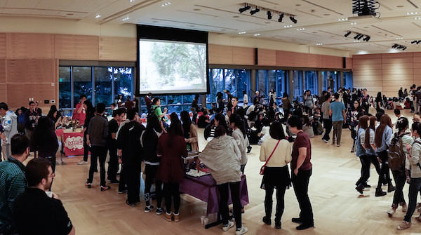 Students in a large room playing games